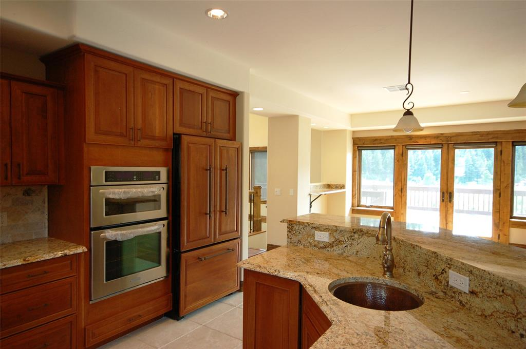 Double Oven, Salad Sink, Granite Counter Tops