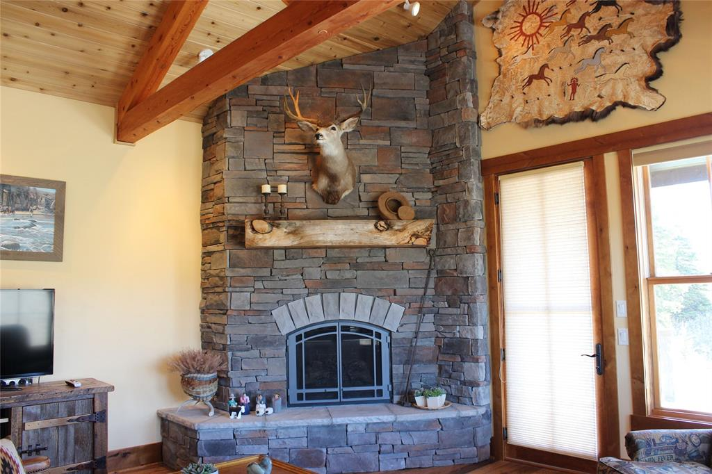 Floor to ceiling stone fireplace with propane inse