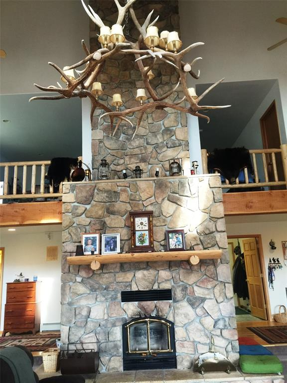 29\' fireplace with elk chandelier